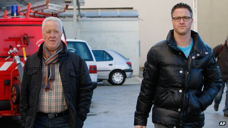 Michael Schumacher's father Rolf, left, and brother Ralf arrive at Grenoble Hospital, French Alps, (Jan. 5, 2014)