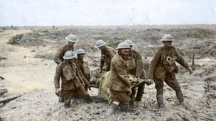 soldiers carrying a wounded soldier