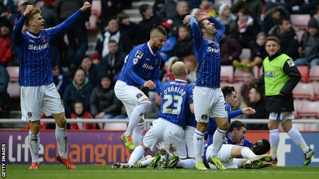 Players of Carlisle United celebrate after Matt Robson (unseen) scored against Sunderland
