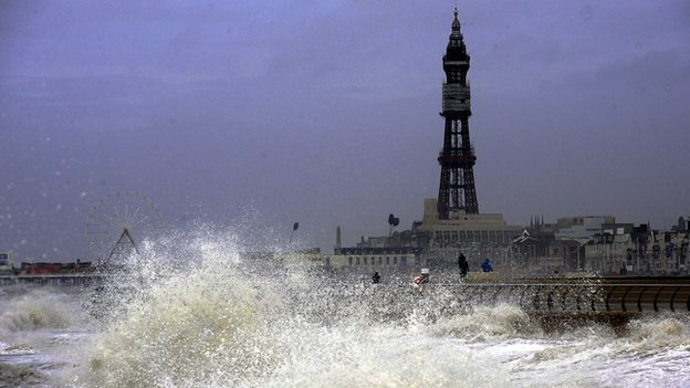 Waves crash on to the promenade at Blackpool as high tides and huge waves hit the west coast of the UK