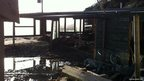 Seaton Beach Cafe, Cornwall, which has been damaged by rough seas