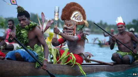 "The Queen""s Baton being transported by wooden canoe from Kavieng to Nusa island in Papua New Guinea in October 2013"