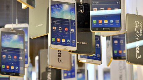 Cardboard cut-outs of Samsung Galaxy Note 3 on display