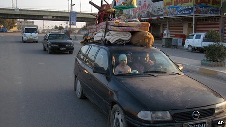 Iraqi family leave Fallujah. 6 Jan 2014