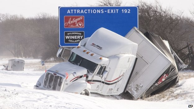 A wrecked semi truck sat in a highway ditch in St. Joseph, Illinois on 6 January 2014