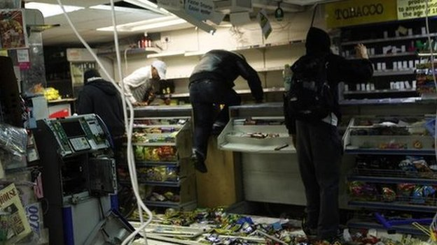 Looters rifle through a store in east London during the August 2001 riots