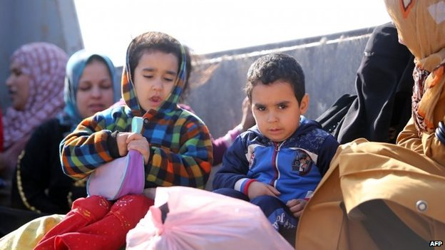 Children refugees from Fallujah in the back of a truck