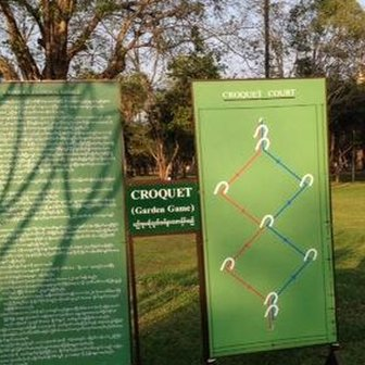 Instructions for playing croquet in Yangon park, Myanmar
