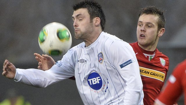 Coleraine's Eoin Bradley shields the ball from Cliftonville's Jamie McGovern