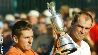 Thomas Bjorn looking at Ben trophy hoisting aloft the claret jug in 2003.