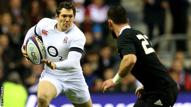 Alex Goode takes on New Zealand's Ryan Crotty