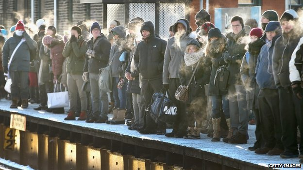 Passengers wait for a train in below-zero temperatures in Chicago, Illinois, on 7 January 2014