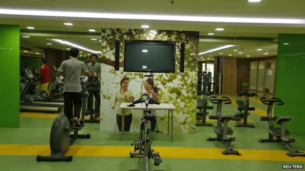 Employees work out at a gym inside an office building in Noida on the outskirts of Delhi.