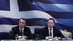 Greece's Finance Minister Yannis Stournaras (R) and Deputy Finance Minister Christos Staikouras