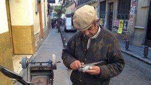 Antonio sharpening a knife