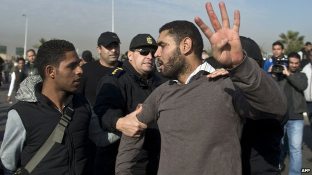 Supporter of Mohammed Morsi arrested outside police compound (8 January)