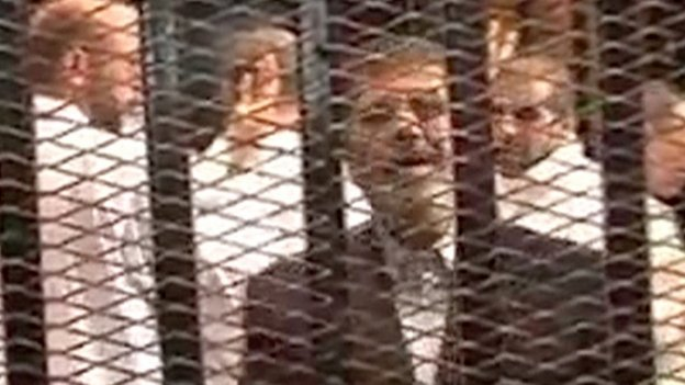 Mohammed Morsi was shown on state TV during his first court appearance on 4 November 2013