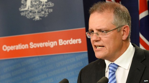 "Australian Minister for Immigration and Border Protection Scott Morrison speaks on the new federal government's Operation Sovereign Borders policy during a press conference in Sydney on 23 September 2013 promising a tougher approach on asylum seekers arriving by sea as part of the government's promise to ""stop the boats"""