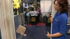 Sara Rosenthal of Ecovacs shows the BBC how the Winbot works