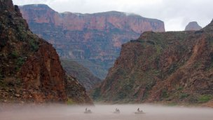 Three wooden boats in Grand Canyon