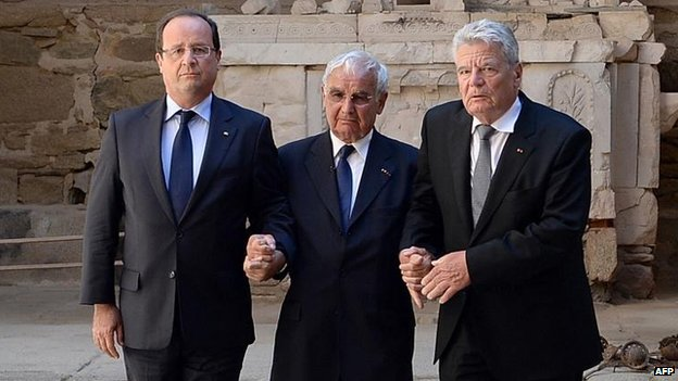 Francois Hollande (left) with German counterpart Joachim Gauck (right) and survivor Robert Hebras, 4 Sept