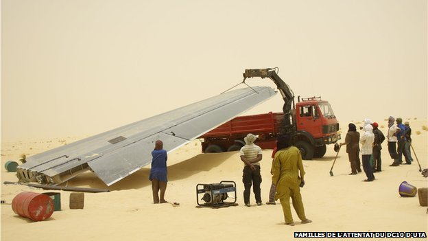 the plane's wing is loaded onto a truck