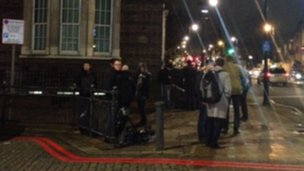 Press gathered outside police station in Tottenham
