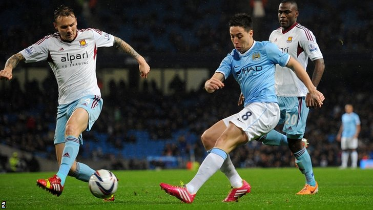 Samir Nasri shoots at the West Ham goal