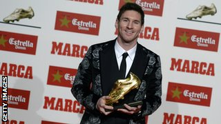 Barcelona's Argentinian forward Lionel Messi poses after receiving his Golden Boot 2013 award, presented to Europes best goal scorer of the 2012-2013 season on November 20, 2013 in Barcelona.
