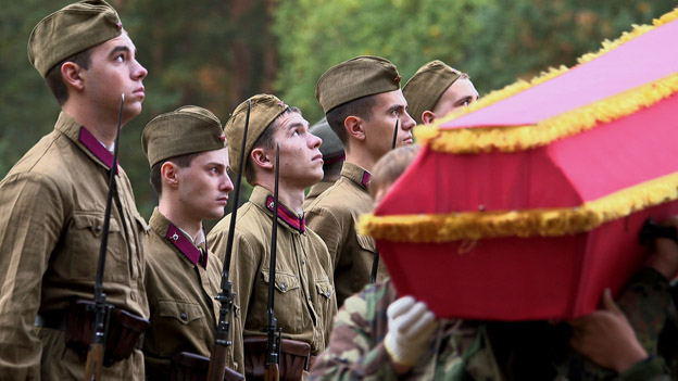 young men look up during burial