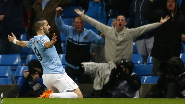 Alvaro Negredo celebrates scoring for Manchester City