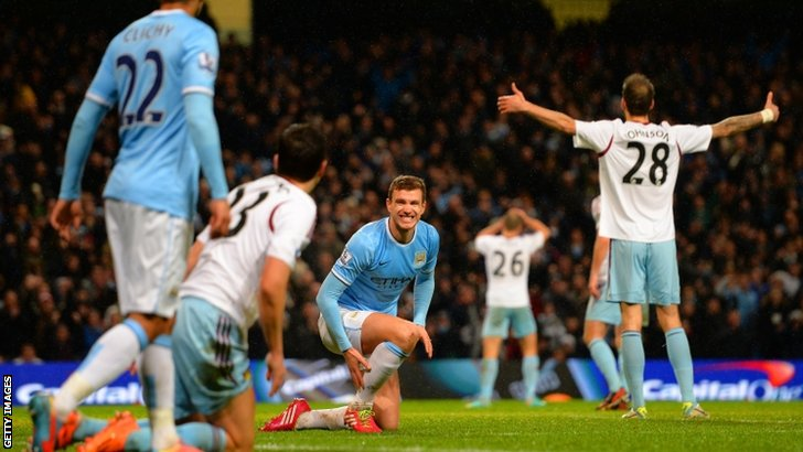 Edin Dzeko (third left) looks on after scoring for Manchester City
