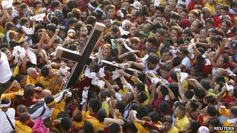 Devotees crowd around the Black Nazarene statue in Manila