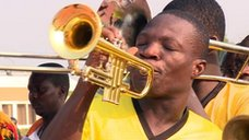 Ghana fan plays trumpet