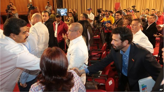 President Maduro shaking hands with Henrique Capriles