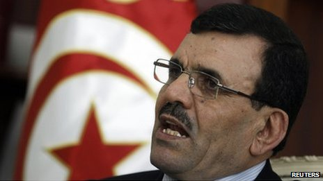 Tunisia's Prime Minister Ali Larayedh speaks during an interview in Tunis on 19 October 2013