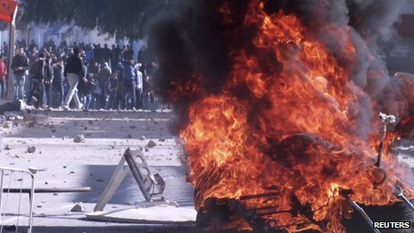 demonstrators and tyres on fire