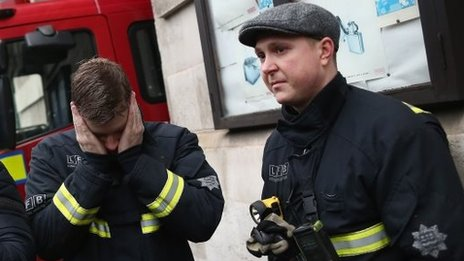 Firefighters stand outside Westminster Fire station after their last shift there