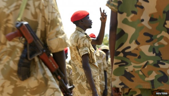 South Sudanese soldiers gather for a briefing at the army general headquarters in Juba