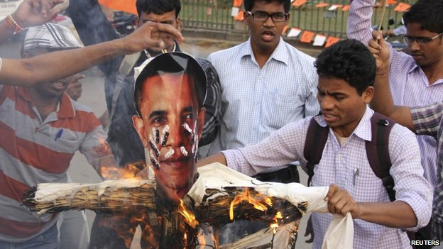 "Activists of Akhil Bharatiya Vidyarthi Parishad (ABVP), linked to India""s main opposition Bharatiya Janata Party (BJP), burn an effigy depicting U.S. President Barack Obama"