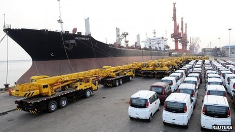 Vans and cranes are parked in a port in Lianyungang, Jiangsu province