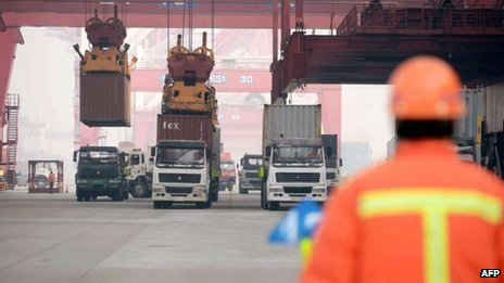 "Containers are transported in a port in Qingdao, east China""s Shandong province"
