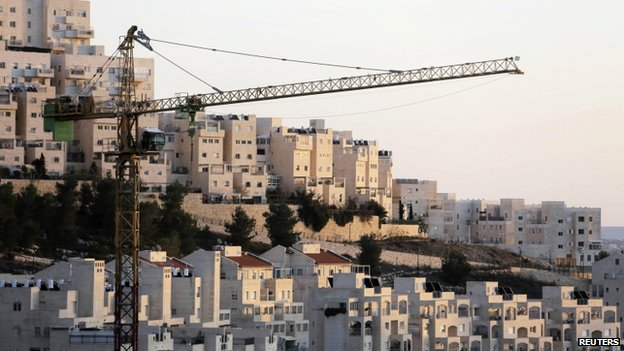 A crane is seen next to homes in a Jewish settlement near Jerusalem known to Israelis as Har Homa and to Palestinians as Jabal Abu Ghneim January 3, 2014