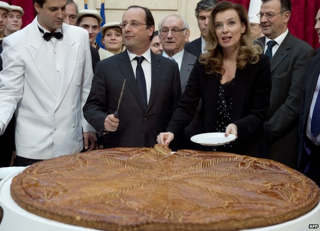 French President Francois Hollande and Valerie Trierweiler attend an epiphany cake-cutting at the Elysee Palace in Paris, 7 January