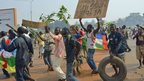 "Anti-Seleka demonstrators holding a placard reading ""Djotodia Resign"" march to Mpoko airport on January 10, 2014 in Bangui, Central African Republic"