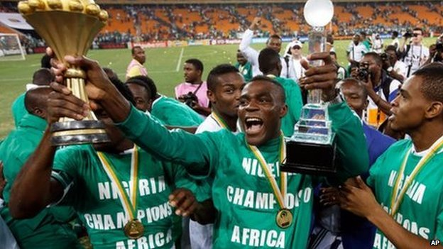 Nigeria's Emmanuel Emenike holds the trophy after they defeated Burkina Faso in the final to win the African Cup of Nations at the Soccer City Stadium in Johannesburg, South Africa, on 10 February 2013