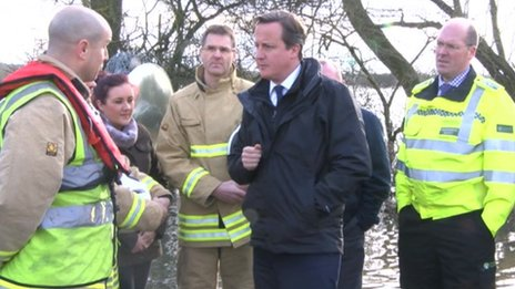 David Cameron with emergency services