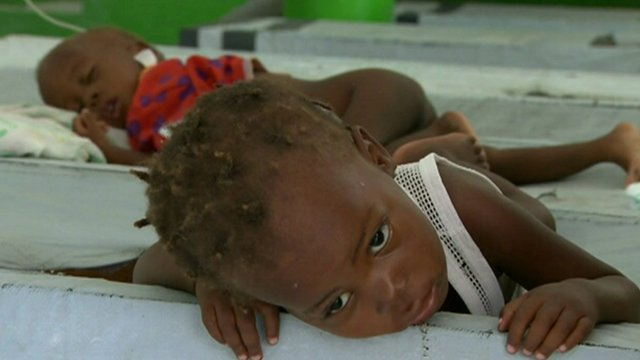 Children with cholera in hospital beds