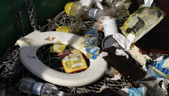 Rubbish collected by a garbage-collecting barge at the Guanabara Bay