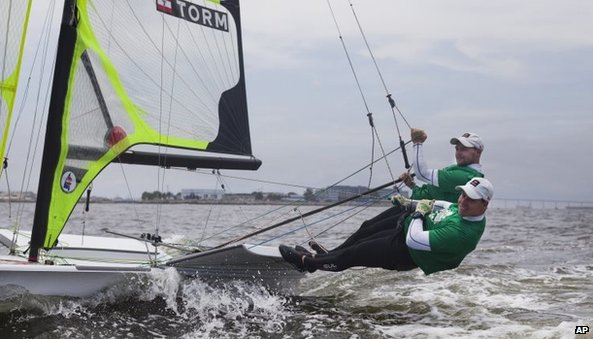 Danish sailors Allan Norregaard (right) and Anders Thomsen warm up before an international sailing competition on the waters of Guanabara Bay